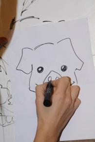 Daniela Sbrana disegna maialini per i bimbi